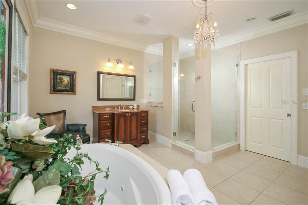 Master bath with glass enclosed shower, dual vanities. - Single Family Home for sale at 7153 Hawks Harbor Cir, Bradenton, FL 34207 - MLS Number is A4434661