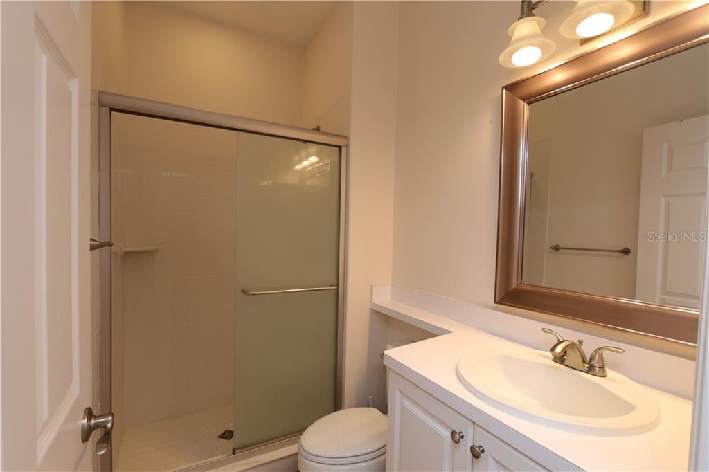 Main floor bathroom - Single Family Home for sale at 5082 47th St W, Bradenton, FL 34210 - MLS Number is A4435806