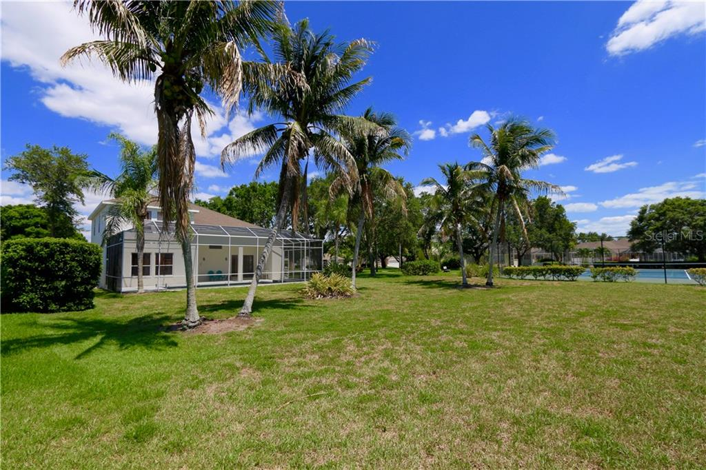 Community tennis / pickle ball court is adjacent to the back yard - Single Family Home for sale at 5082 47th St W, Bradenton, FL 34210 - MLS Number is A4435806
