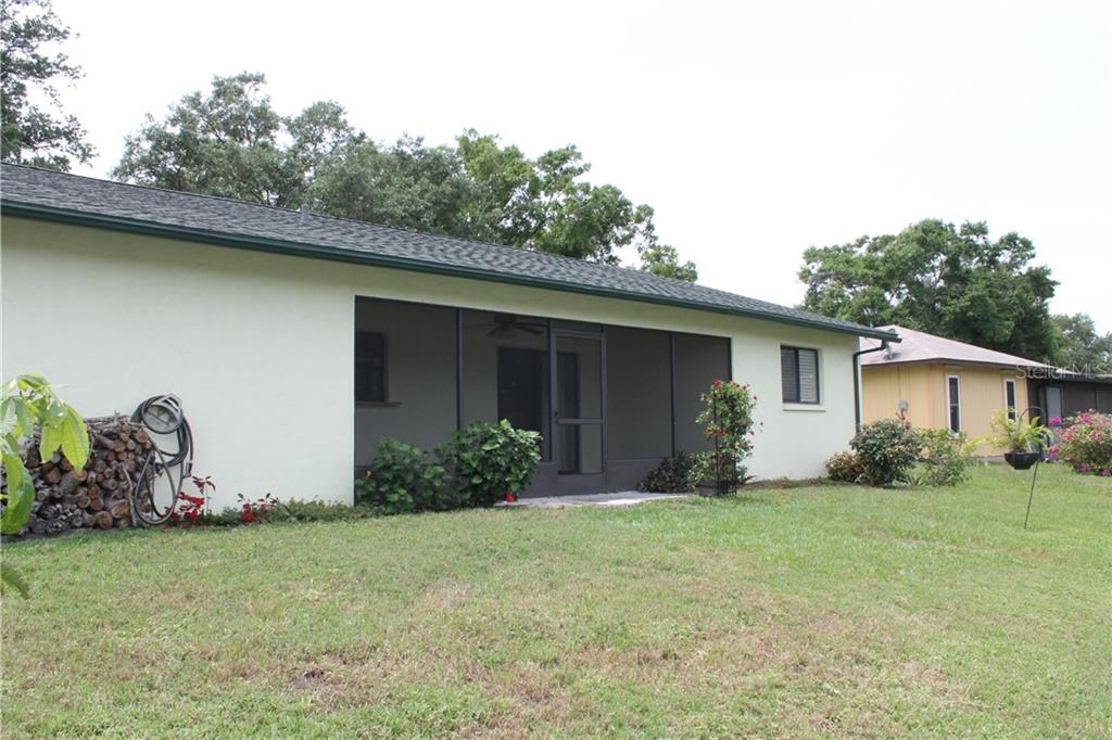 Rear exterior facing the pond. - Single Family Home for sale at 4803 Glenbrooke Dr, Sarasota, FL 34243 - MLS Number is A4435920