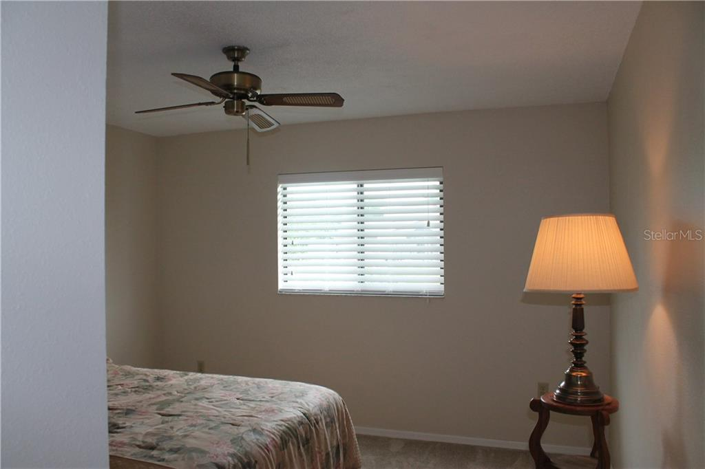 Third bedroom 12x13 over looks the pond. - Single Family Home for sale at 4803 Glenbrooke Dr, Sarasota, FL 34243 - MLS Number is A4435920