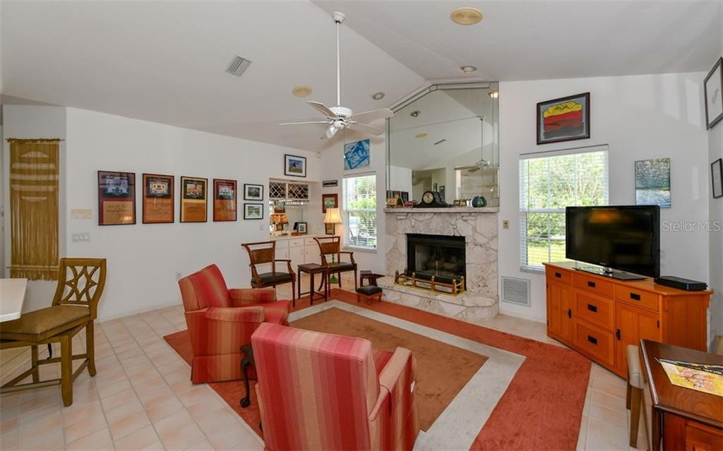 family room - Single Family Home for sale at 5401 Downham Meadows, Sarasota, FL 34235 - MLS Number is A4436577