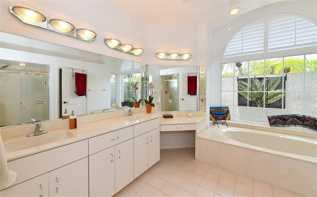Master bath with garden tub and privacy garden wall....lots of light!  Also separate shower and commode. - Single Family Home for sale at 5401 Downham Meadows, Sarasota, FL 34235 - MLS Number is A4436577