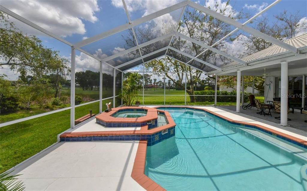 Sparkling pool and Spa - Single Family Home for sale at 5401 Downham Meadows, Sarasota, FL 34235 - MLS Number is A4436577