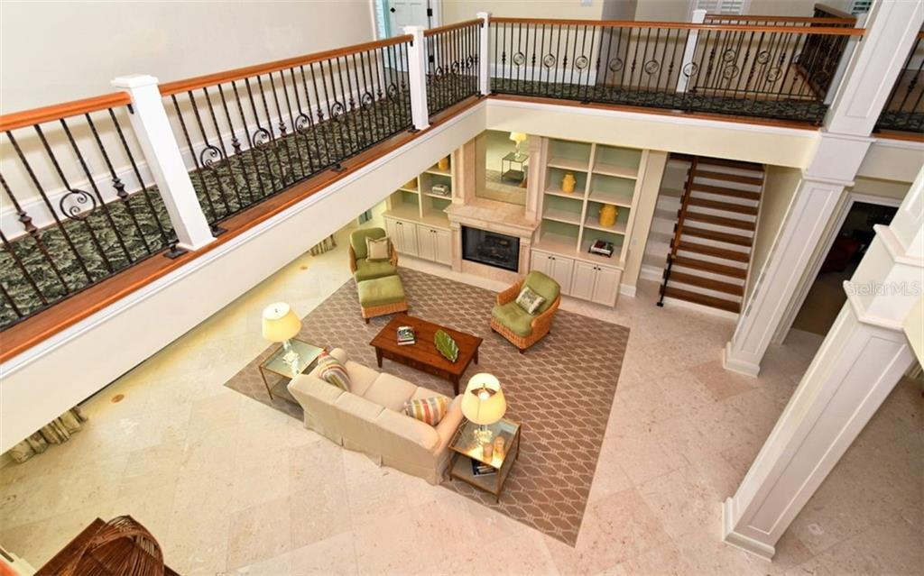 View from the second level into the living room - Single Family Home for sale at 65 Lighthouse Point Dr, Longboat Key, FL 34228 - MLS Number is A4438181