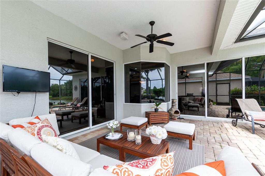 Large patio area under roof - rear of property is facing south so you can enjoy morning, afternoons and evening around the pool. - Single Family Home for sale at 13818 Nighthawk Ter, Lakewood Ranch, FL 34202 - MLS Number is A4438487