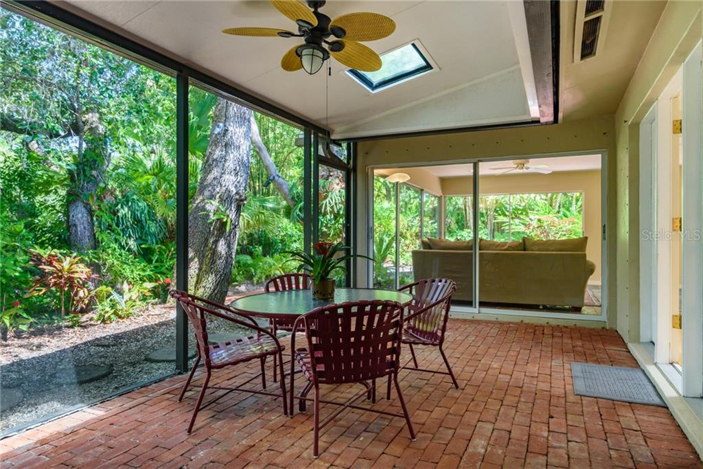 Screened lanai toward Florida room - Single Family Home for sale at 8511 Heron Lagoon Cir, Sarasota, FL 34242 - MLS Number is A4439489