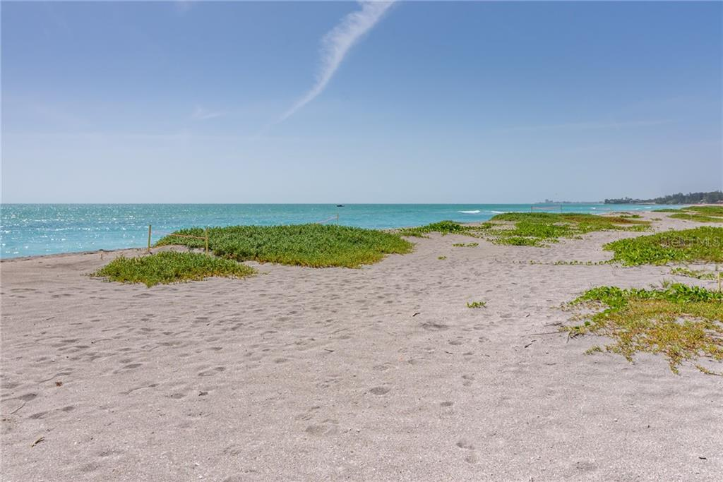 Beach view looking north to Sanderling Club & Point of Rocks - Single Family Home for sale at 8511 Heron Lagoon Cir, Sarasota, FL 34242 - MLS Number is A4439489