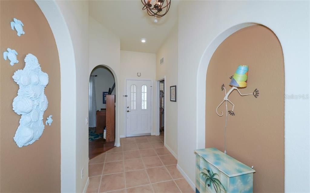 Foyer entry adjacent to den and bonus room. - Condo for sale at 200 San Lino Cir #233, Venice, FL 34292 - MLS Number is A4440138