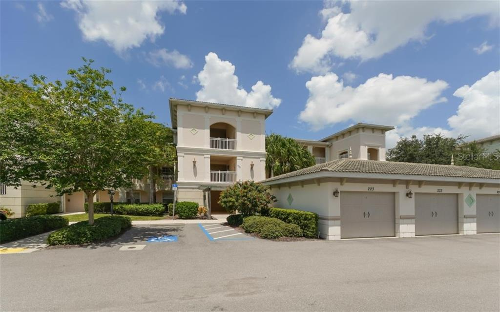 Detached one car garage with a wall of built-in cabinetry for abundant storage and organization. - Condo for sale at 200 San Lino Cir #233, Venice, FL 34292 - MLS Number is A4440138