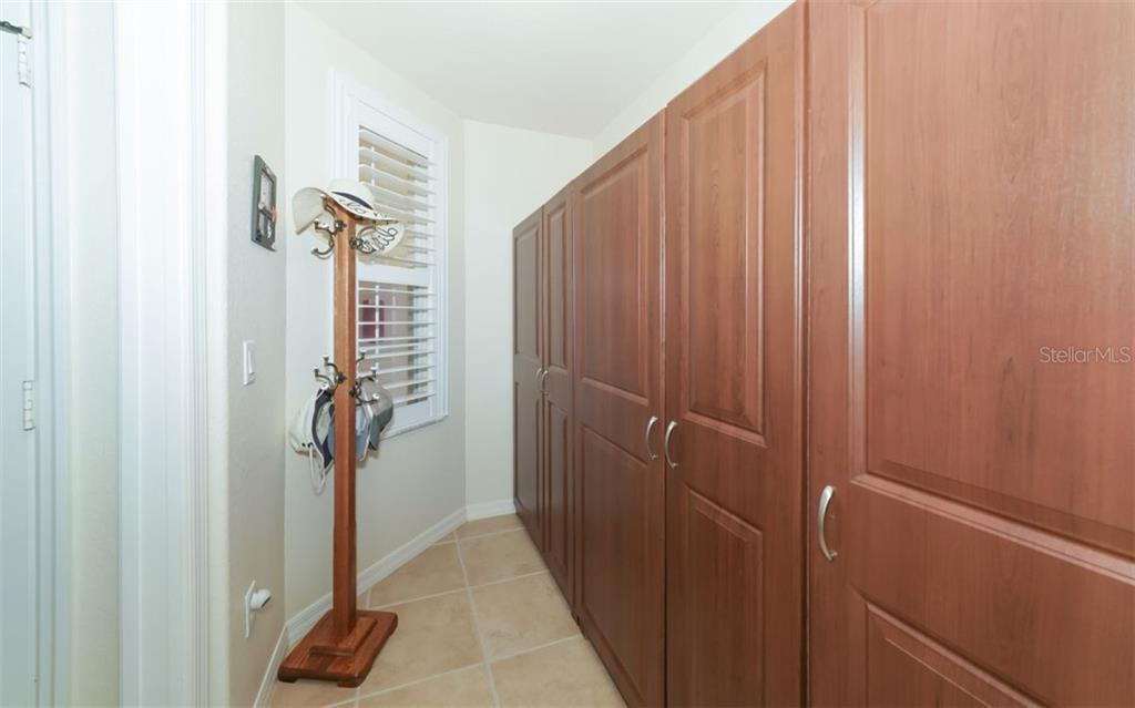 Bonus room with abundant built-in storage cabinets and plantation shutters. - Condo for sale at 200 San Lino Cir #233, Venice, FL 34292 - MLS Number is A4440138