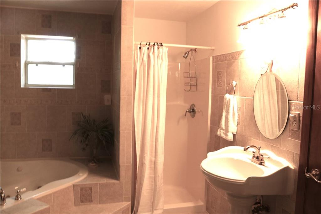 Master bathroom shower and pedestal sink. - Single Family Home for sale at 2220 Pine Ter, Sarasota, FL 34231 - MLS Number is A4440562