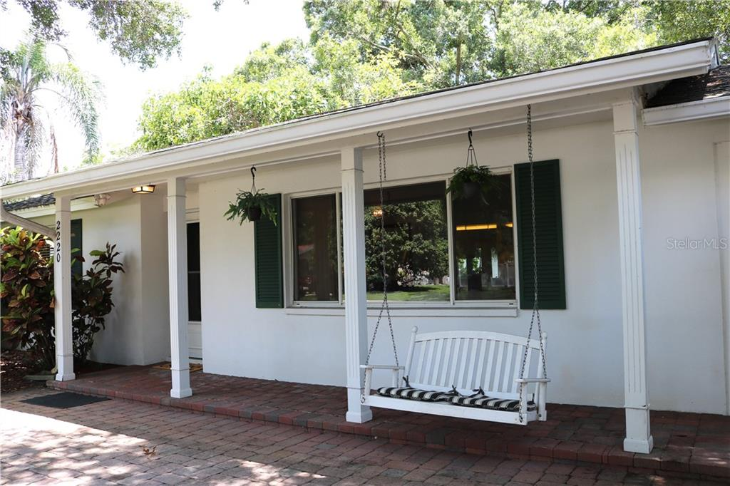 Beautiful shaded front porch for relaxing with a cool drink. - Single Family Home for sale at 2220 Pine Ter, Sarasota, FL 34231 - MLS Number is A4440562