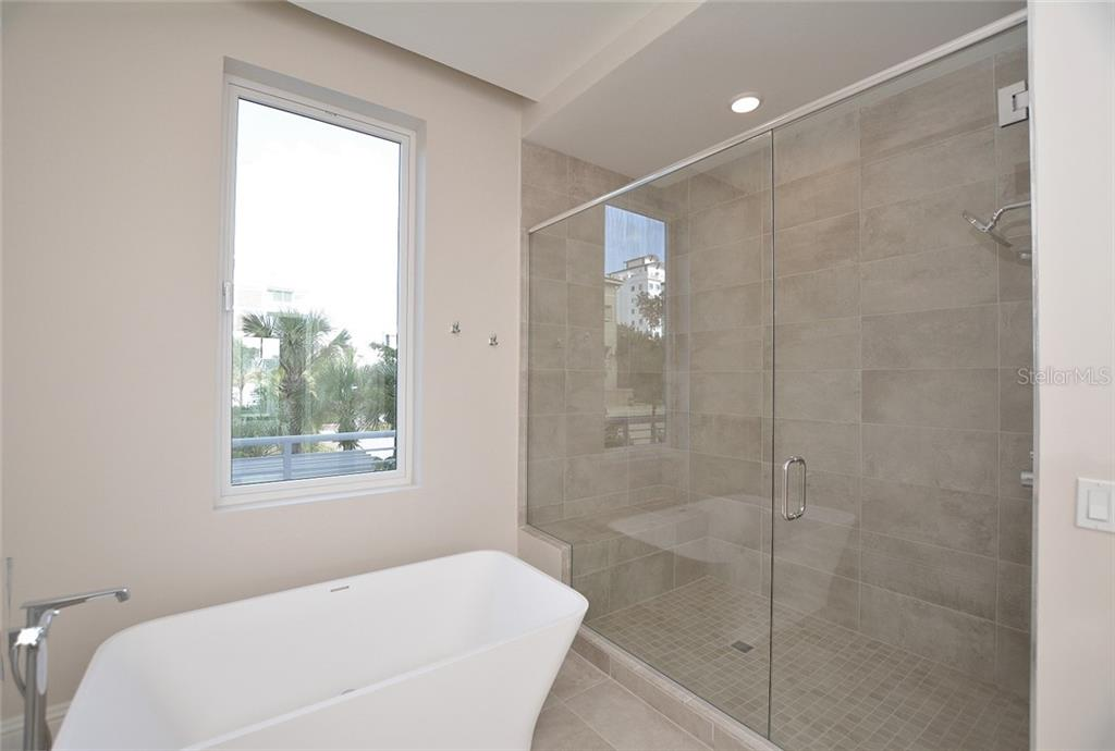 Light and bright with daylight window, deep soaking tub with floor mount hardware. - Condo for sale at 609 Golden Gate Pt #202, Sarasota, FL 34236 - MLS Number is A4441802