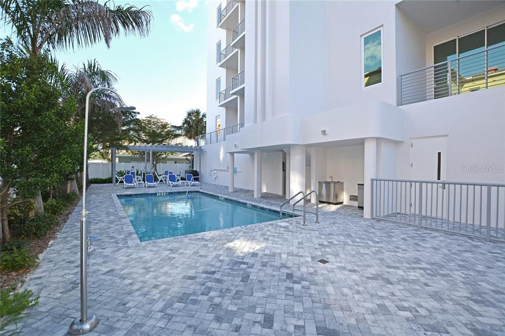 Salt water heated pool and outdoor shower. - Condo for sale at 609 Golden Gate Pt #202, Sarasota, FL 34236 - MLS Number is A4441802