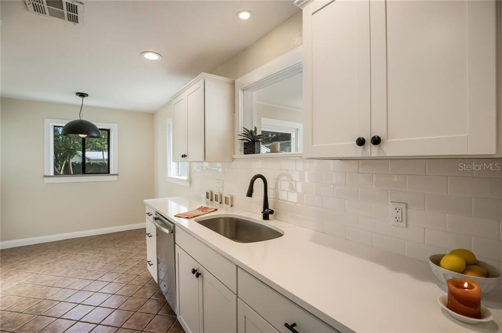 Lovely pass through window from the kitchen to the Florida Room - Single Family Home for sale at 1763 6th St, Sarasota, FL 34236 - MLS Number is A4442510