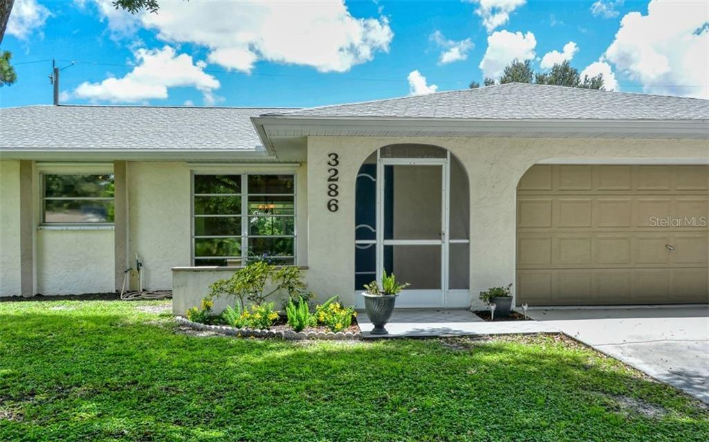 Screened in front entrance allows you to open the front door and enjoy the beautiful breeze - Single Family Home for sale at 3286 Jamestown St, Port Charlotte, FL 33952 - MLS Number is A4444310