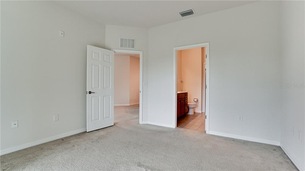 Door on left is from Great room, door on right leads to owner's bath and large walk in closet - Condo for sale at 7815 Moonstone Dr #24-204, Sarasota, FL 34233 - MLS Number is A4446867