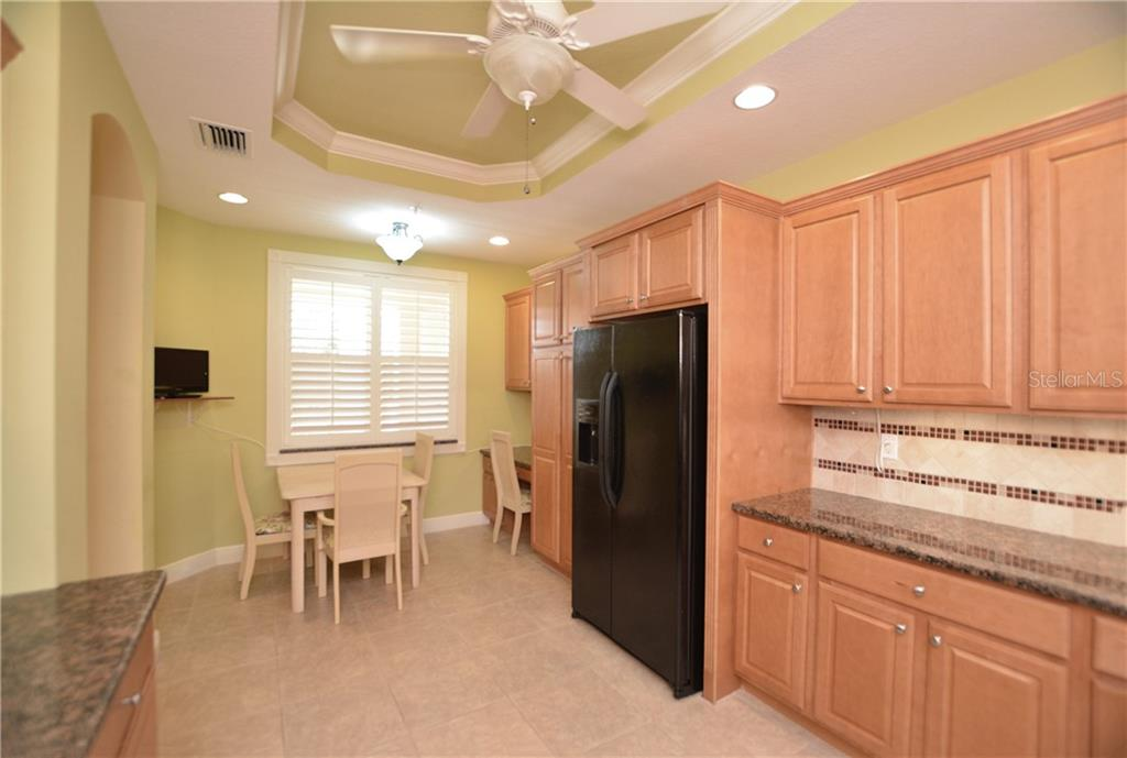 Spacious kitchen with breakfast area and built-in desk. - Condo for sale at 5304 Manorwood Dr #2b, Sarasota, FL 34235 - MLS Number is A4448585