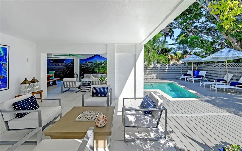 Relax around the firepit. - Single Family Home for sale at 5365 Calle Florida, Sarasota, FL 34242 - MLS Number is A4449055