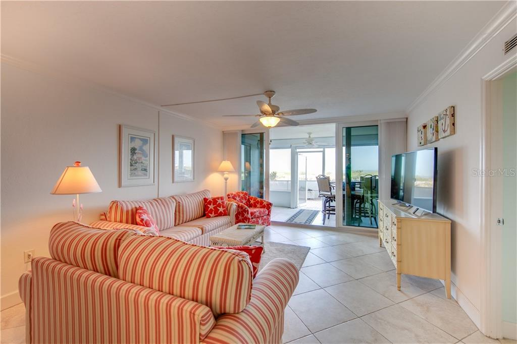 View of the living room from the edge of the dining room. - Condo for sale at 555 The Esplanade N #102, Venice, FL 34285 - MLS Number is A4450635