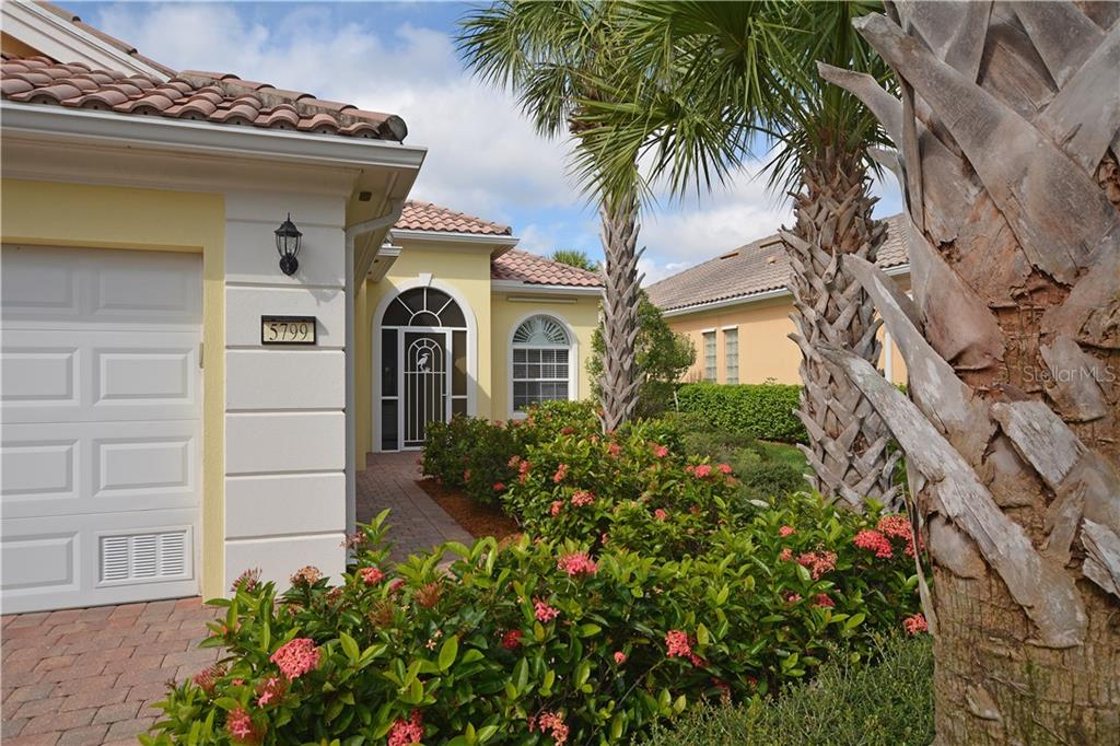 Solid construction with poured concrete, tile roof, newer AC (2018) & oversized lanai. - Single Family Home for sale at 5799 Benevento Dr, Sarasota, FL 34238 - MLS Number is A4450677