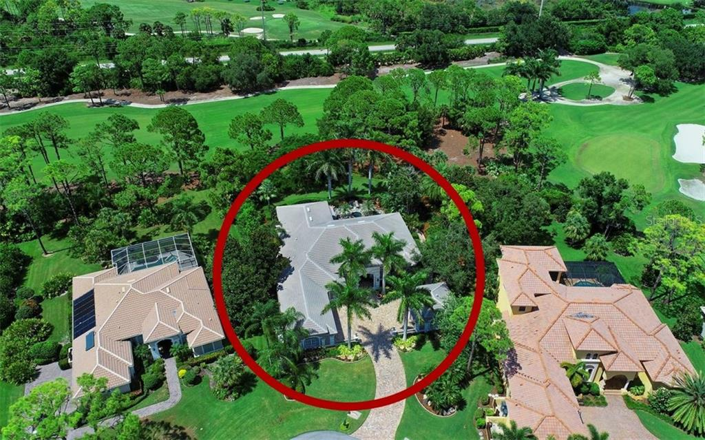 Half-acre lot surrounded by lush tropical landscaping with the 12th Fairway beyond. - Single Family Home for sale at 586 N Macewen Dr, Osprey, FL 34229 - MLS Number is A4451482
