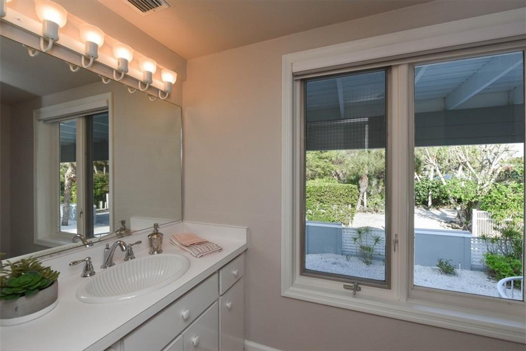 1/2 bath - Single Family Home for sale at 1027 N Casey Key Rd, Osprey, FL 34229 - MLS Number is A4451976