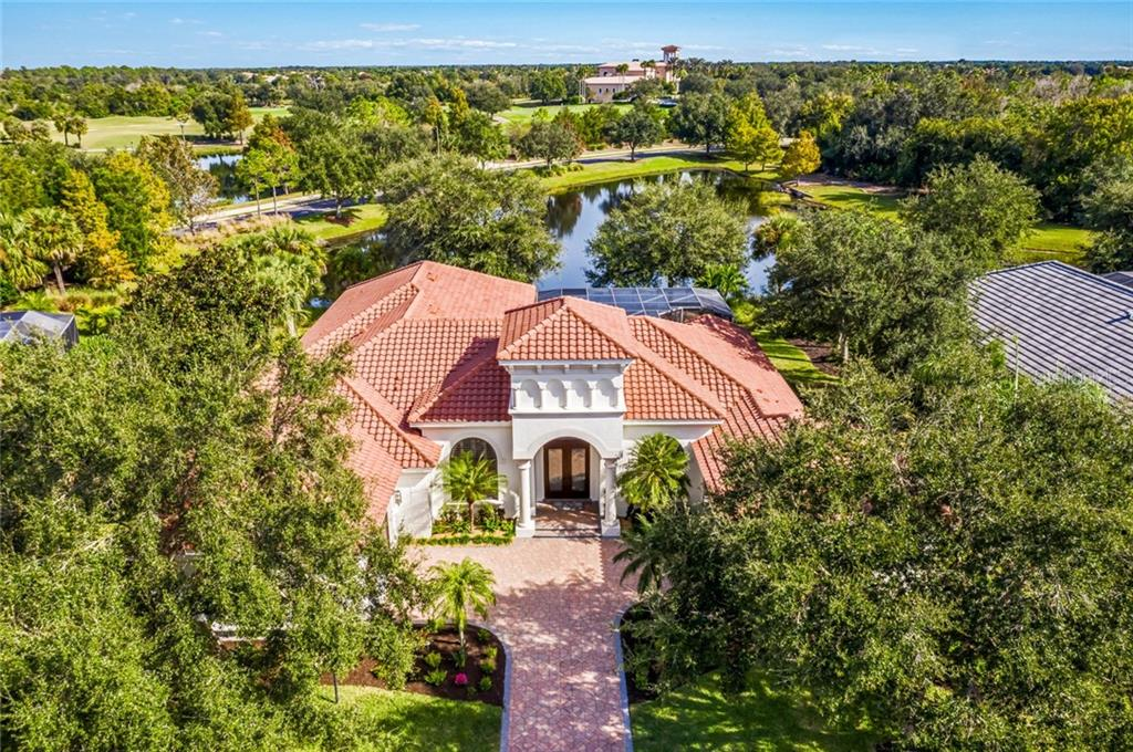 BEAUTFUL WATERFRONT LOT WITH MATURE LANDSCAPING AND PRIVACY. - Single Family Home for sale at 12551 Highfield Cir, Lakewood Ranch, FL 34202 - MLS Number is A4452079