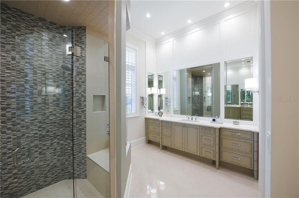 His Master Vanity Area with Private Water Closet to the Right. - Single Family Home for sale at 16119 Baycross Dr, Lakewood Ranch, FL 34202 - MLS Number is A4452632