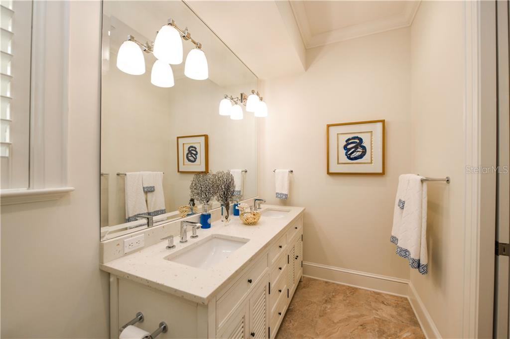 Casita En-Suite Bathroom with Dual Sinks. - Single Family Home for sale at 16119 Baycross Dr, Lakewood Ranch, FL 34202 - MLS Number is A4452632