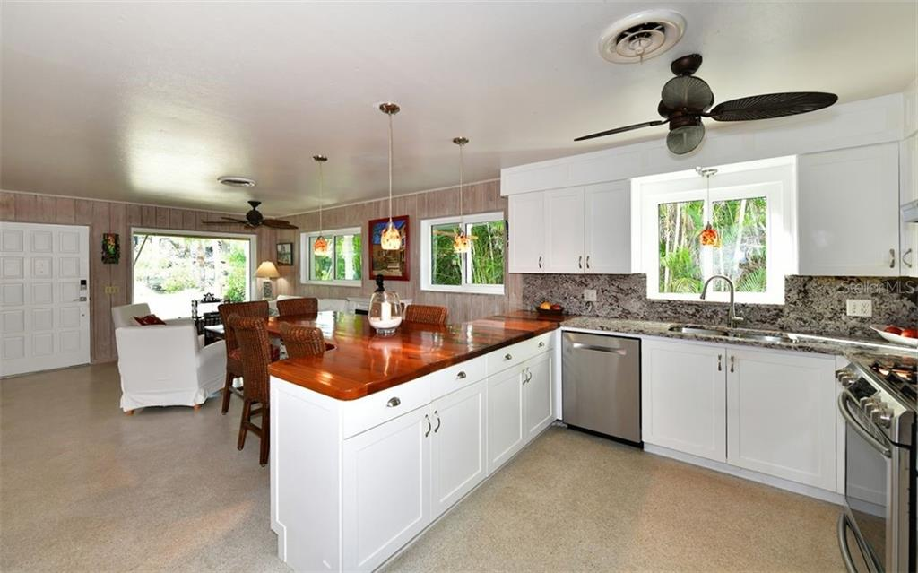 Custom cedar wood counter with integrated dining - Single Family Home for sale at 623 Avenida Del Norte, Sarasota, FL 34242 - MLS Number is A4454692