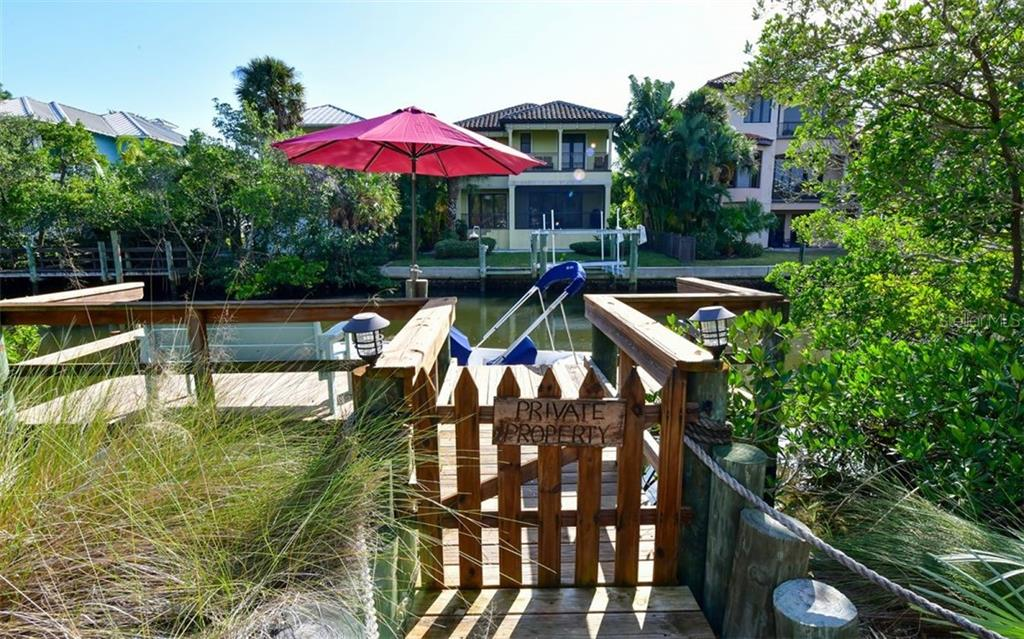 Private boat dock and shoreline, protected by wooden sea wall - Single Family Home for sale at 623 Avenida Del Norte, Sarasota, FL 34242 - MLS Number is A4454692