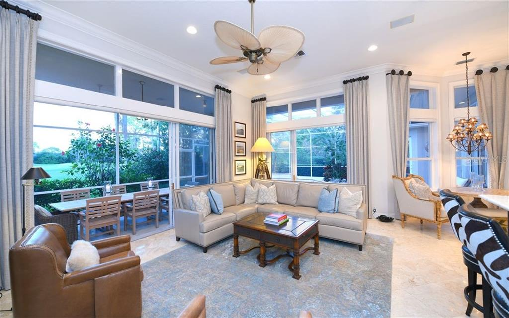 Family room - Single Family Home for sale at 574 N Macewen Dr, Osprey, FL 34229 - MLS Number is A4455085