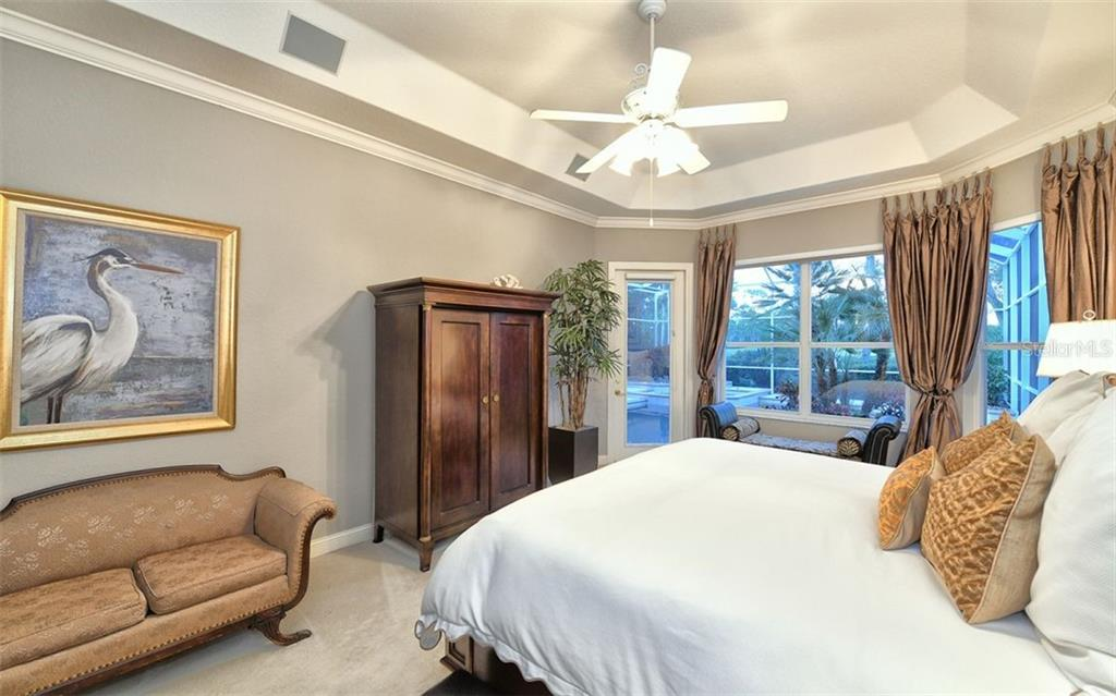 Master bedroom with door to pool - Single Family Home for sale at 574 N Macewen Dr, Osprey, FL 34229 - MLS Number is A4455085