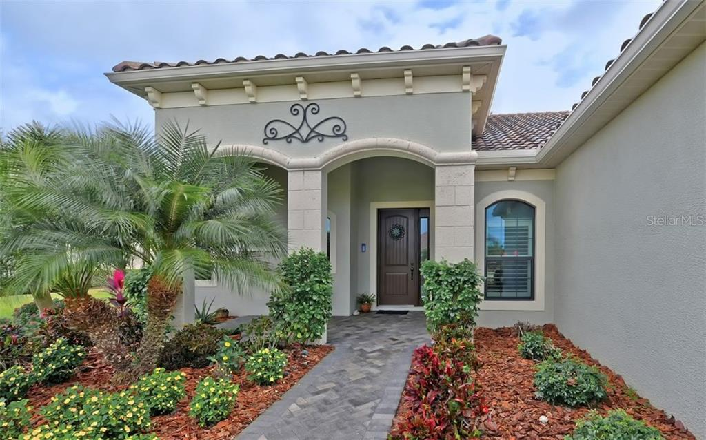 Front Entry - Single Family Home for sale at 8260 Larkspur Cir, Sarasota, FL 34241 - MLS Number is A4455087