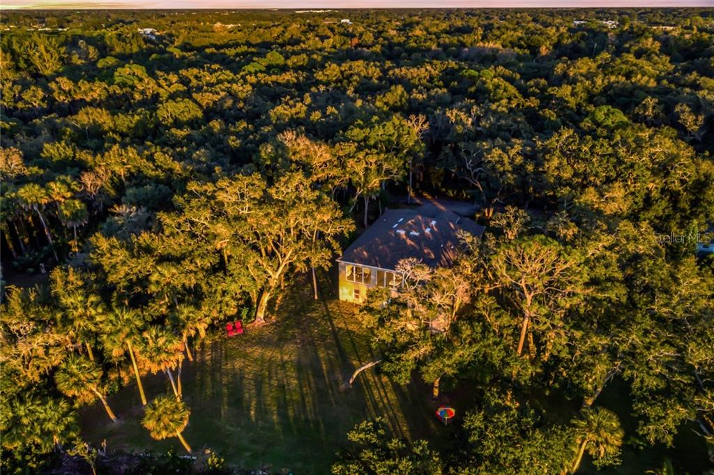 Aerial view of the home surrounded by nature. - Single Family Home for sale at 6125 1st Ter E, Palmetto, FL 34221 - MLS Number is A4455618