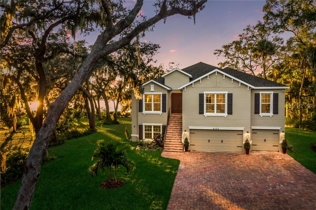 Stunning twilight setting. - Single Family Home for sale at 6125 1st Ter E, Palmetto, FL 34221 - MLS Number is A4455618