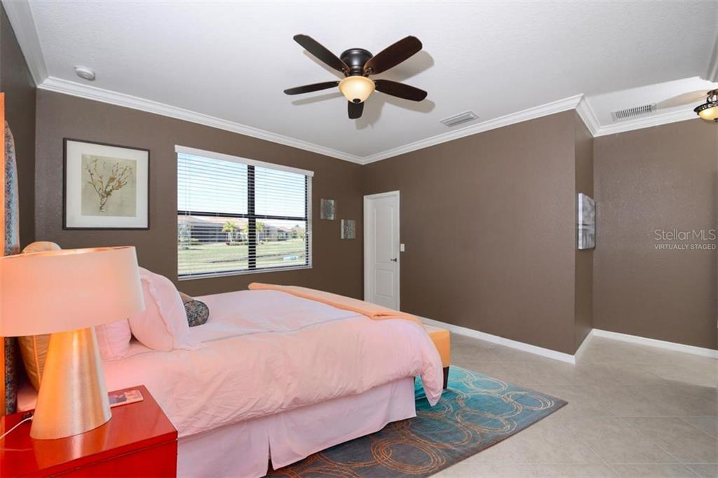 Master bedroom virtually staged. - Single Family Home for sale at 214 Whispering Palms Ln, Bradenton, FL 34212 - MLS Number is A4458542