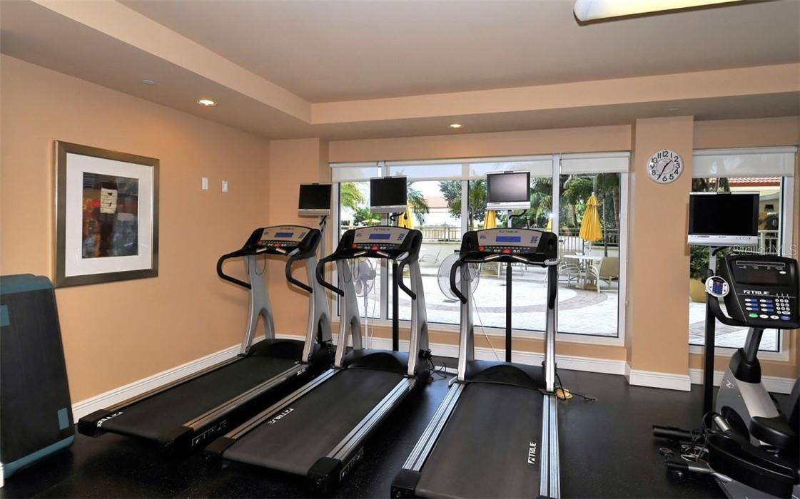 Fitness center overlooks the pool deck - Condo for sale at 100 Central Ave #A304, Sarasota, FL 34236 - MLS Number is A4458873