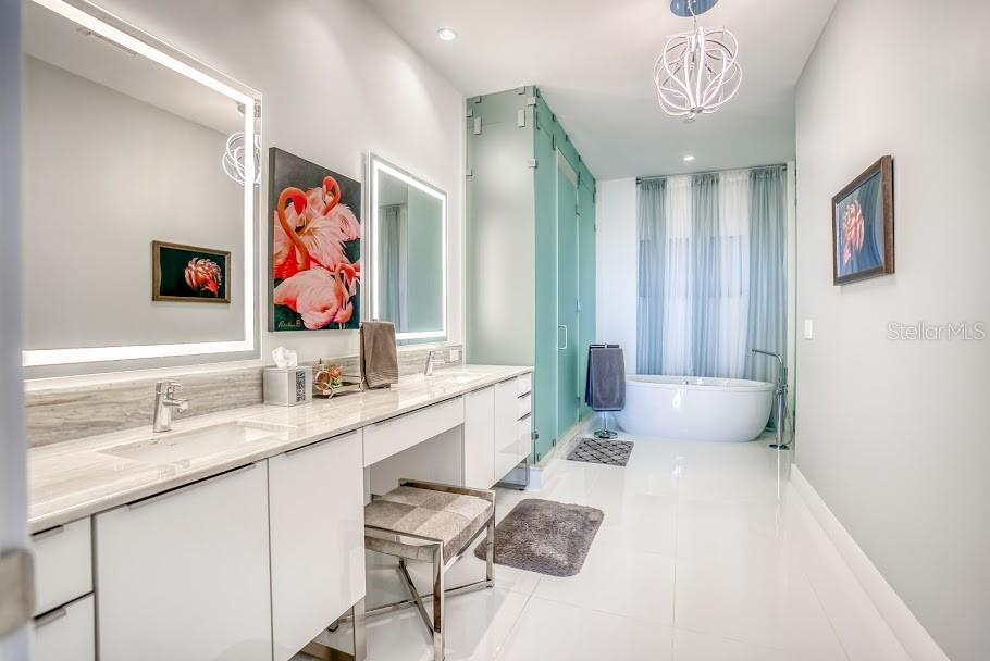 Owner's En Suite featuring electric back lit mirrors, soaking tub, dual vanities, and huge shower. - Condo for sale at 1155 N Gulfstream Ave #1909, Sarasota, FL 34236 - MLS Number is A4461040