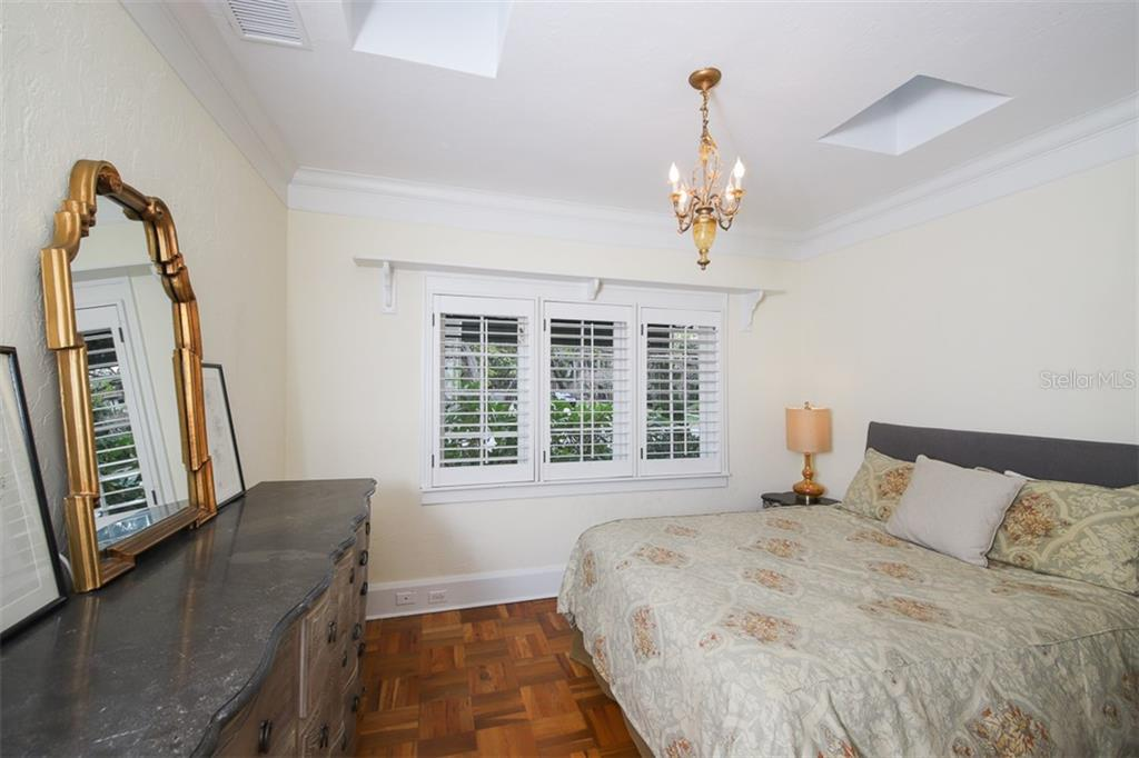 Guest bedroom with plantation shutters - Single Family Home for sale at 3838 Flores Ave, Sarasota, FL 34239 - MLS Number is A4461669
