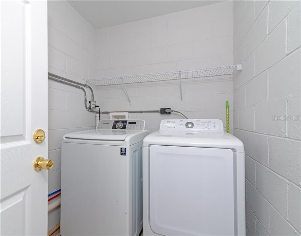 Separate Laundry Room with Access to Kitchen and Carport. - Single Family Home for sale at 5057 Bell Meade Dr, Sarasota, FL 34232 - MLS Number is A4461883
