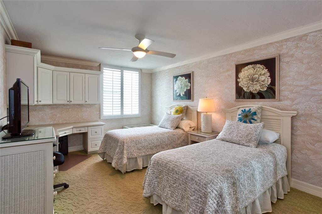 Guest BR ensuite #1 is spacious with built-ins for potential office space. - Condo for sale at 5880 Midnight Pass Rd #911, Sarasota, FL 34242 - MLS Number is A4462559