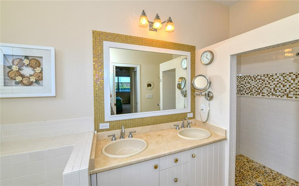 Walk in shower with decorative tile - Villa for sale at 4605 Samoset Dr, Sarasota, FL 34241 - MLS Number is A4463082