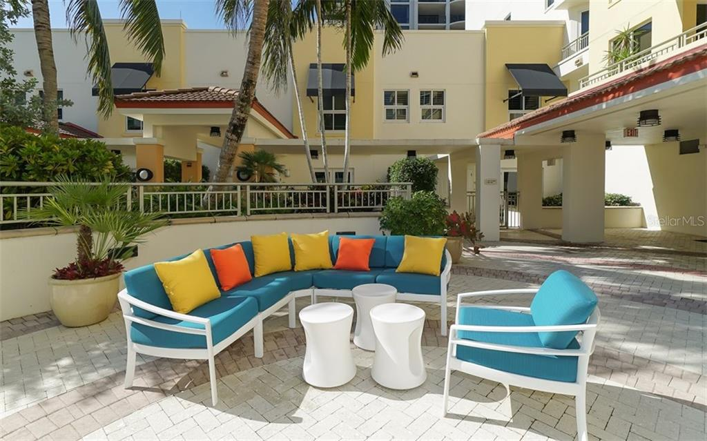 Plenty of resting spaces in the sun or in the shade on the large pool deck - Condo for sale at 100 Central Ave #A401, Sarasota, FL 34236 - MLS Number is A4463296