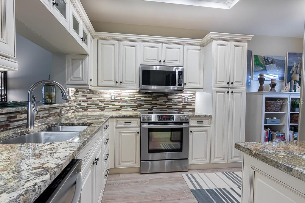 Gorgeous granite and tile back splash - Condo for sale at 9630 Club South Cir #6102, Sarasota, FL 34238 - MLS Number is A4463325