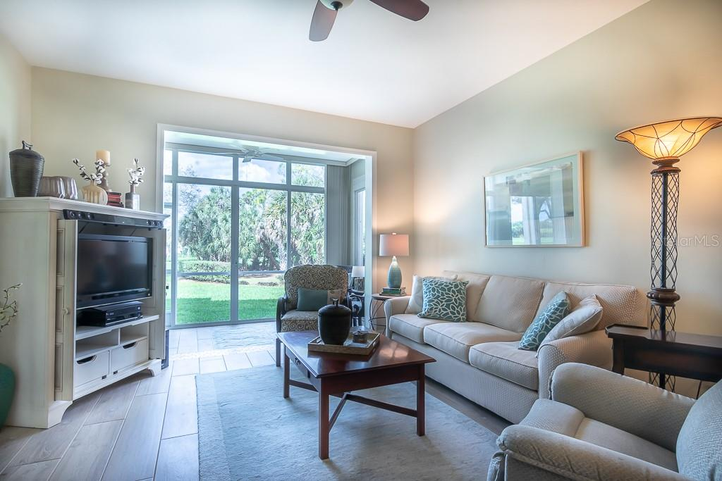 Great room opens to enclosed lanai - Condo for sale at 9630 Club South Cir #6102, Sarasota, FL 34238 - MLS Number is A4463325