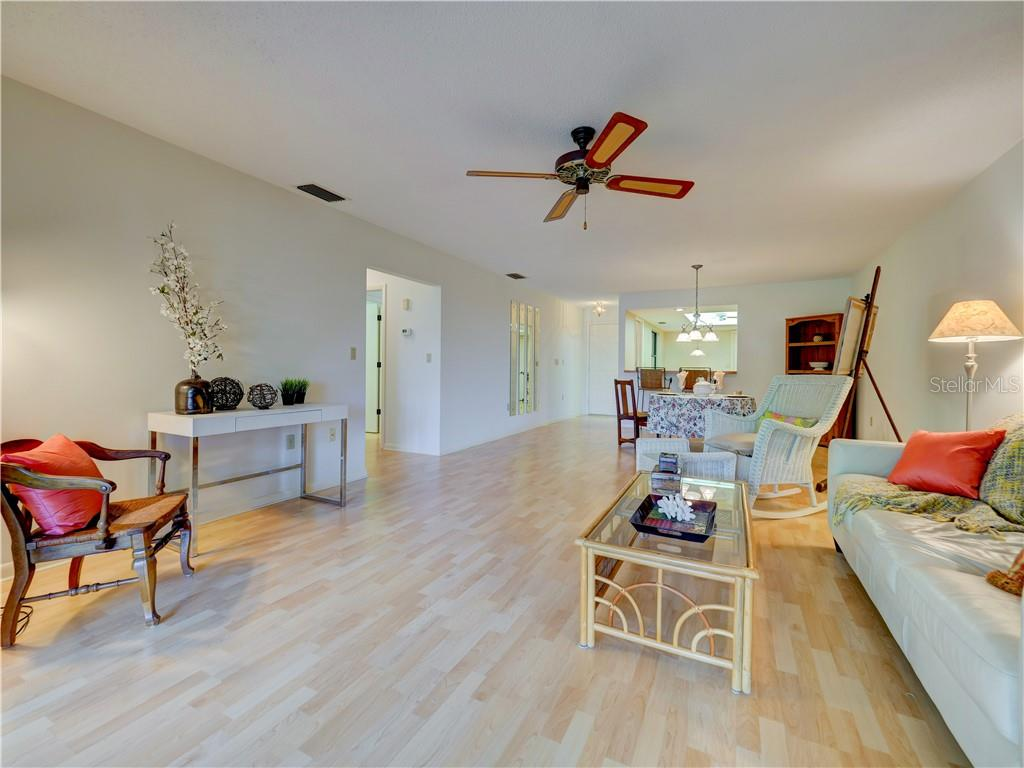 Spacious living area as seen from screened patio - Villa for sale at 4335 Rum Cay Cir, Sarasota, FL 34233 - MLS Number is A4463762