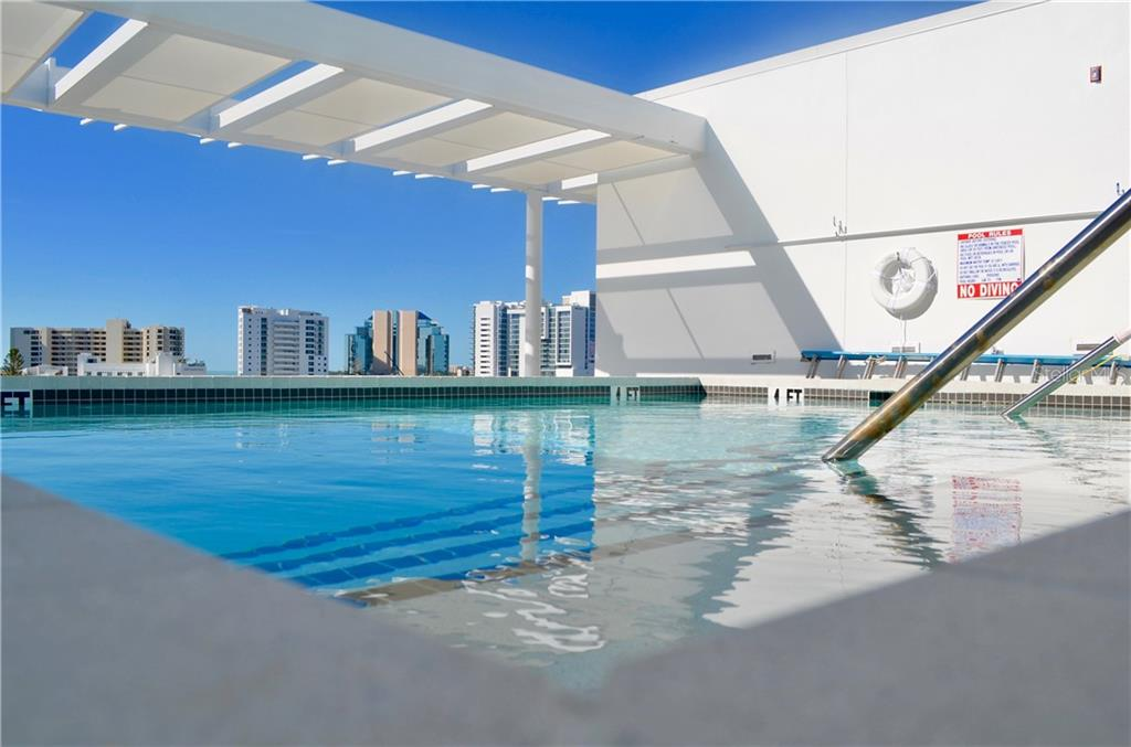 The roof top pool awaits you to take a dip or toast the sunset along the city skyline. - Condo for sale at 1350 5th Street #104, Sarasota, FL 34236 - MLS Number is A4463799